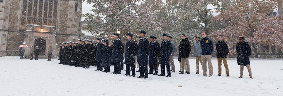 ROTC and students on campus in the snow